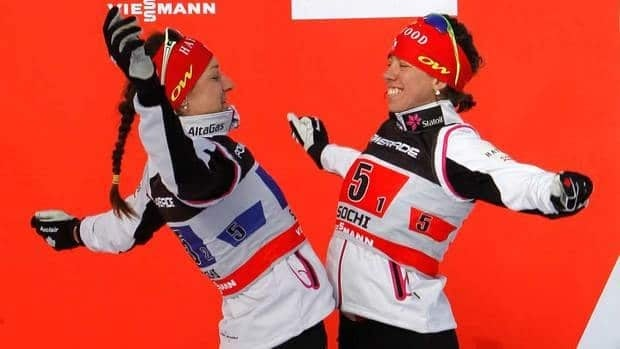 Canada's Daria Gaiazova, left, and Perianne Jones celebrate during the award ceremony after the FIS Cross-Country World Cup in Sochi, Russia on Sunday.