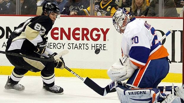 Sidney Crosby, seen tracking a Pittsburgh shot on New York goalie Evgeni Nabokov on Jan. 30, will return after missing 13 games.
