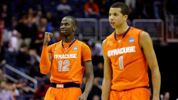 Baye Keita of the Syracuse Orange, left, reacts after a play against the Indiana Hoosiers on March 28, 2013 in Washington, DC.