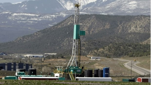 A natural gas well pad sits in front of the Roan Plateau near the Colorado mountain community of Rifle. The practice of hydraulic fracturing to extract natural gas rarely causes tremors, a U.S. government science report says.