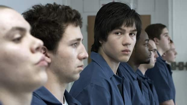 In Blackbird, Connor Jessup (second from right) plays an alienated teenager whose online threat ignites fear and paranoia in a small community.