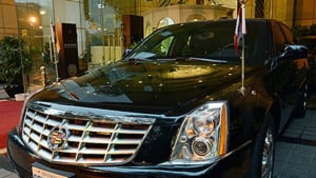 Prime Minister Stephen Harper's armoured Cadillac with Ontario plates is pictured in New Dehli, India. It cost about $1.6 million to transport the prime minister's armoured cars to India.