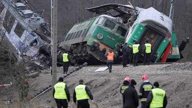 Rescuers work at the site where two trains collided near the small town of Szczekociny in southern Poland.