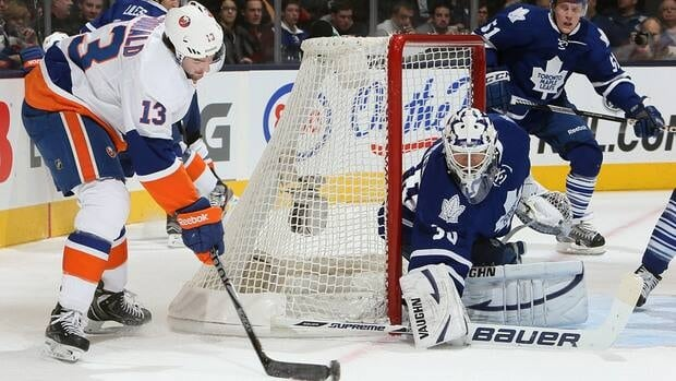 Toronto Maple Leafs goalie Ben Scrivens, right, makes a save on Colin McDonald of the New York Islanders Thursday at the Air Canada Centre in Toronto.