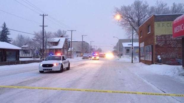 Police tape surrounded the scene near the corner of Robinson Street and 5th Avenue.