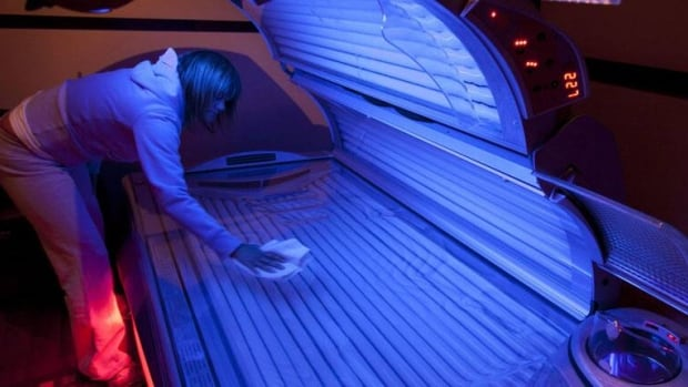 Lisa Shenton of Sunshine Tanning Studios cleans a tanning bed in North Vancouver, B.C. Tuesday, March, 20, 2012. The province of British Columbia is the latest jurisdiction to ban children and teens from using tanning beds due to increased risk of cancer connected to the beds, according to the province's Health Minister Mike de Jong.