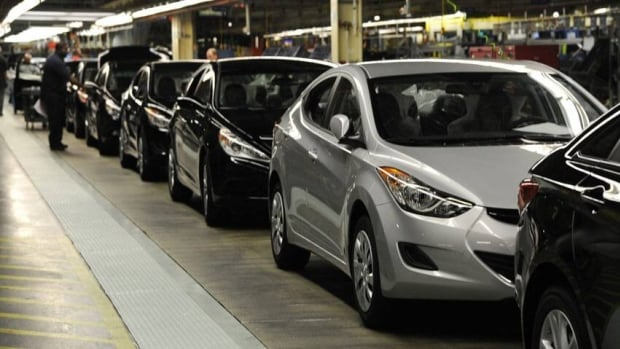 Finished Hyundais move down the production line at the Hyundai plant in Montgomery, Ala.  Hyundai's American CEO says the plant can't keep up with demand.