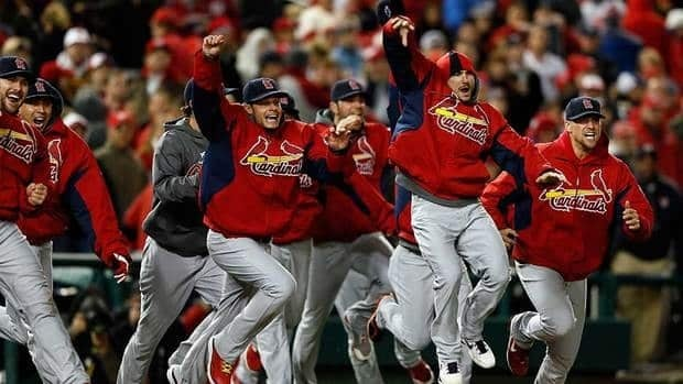 The St. Louis Cardinals celebrate after defeating the Washington Nationals 9-7 in Game 5 of the NLDS at Nationals Park onFriday in Washington, D.C.