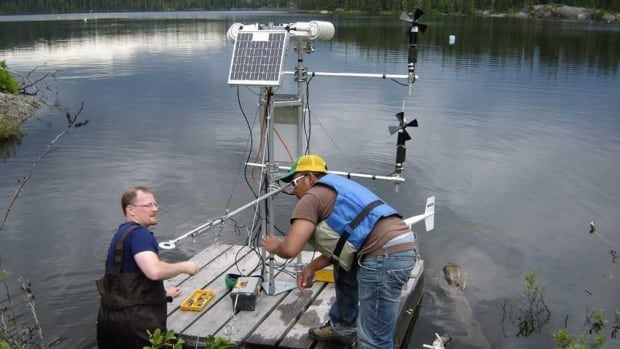 Scientists set-up a raft with one of a series of micro-meterological stations. Ontario, Manitoba and the federal government have struck a deal to maintain the world-famous Experimental Lakes Project.