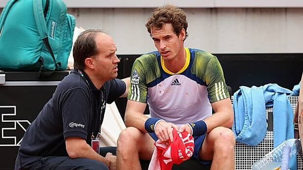 Andy Murray of Great Britain speaks with trainer Clay Sniteman during Wednesday's match in Rome.
