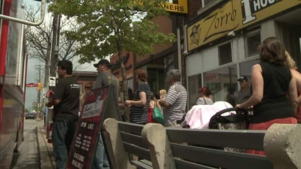 Hamiltonians line up to be served at a food truck on Ottawa Street.