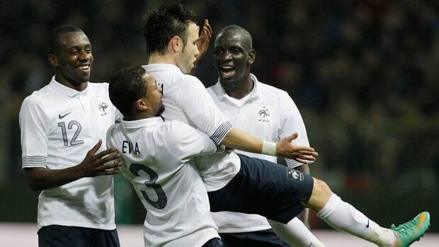 France forward Mathieu Valbuena, gets carried by his teammates after scoring during the friendly at the Parma Tardini stadium in Italy.