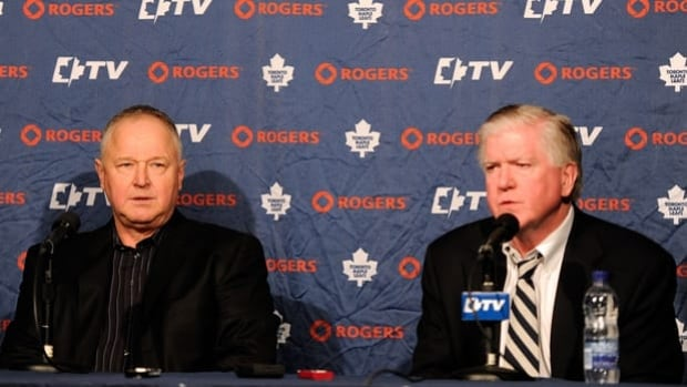 Leafs president and GM Brian Burke, right, hired head coach Randy Carlyle to salvage the season, but the damage was done.