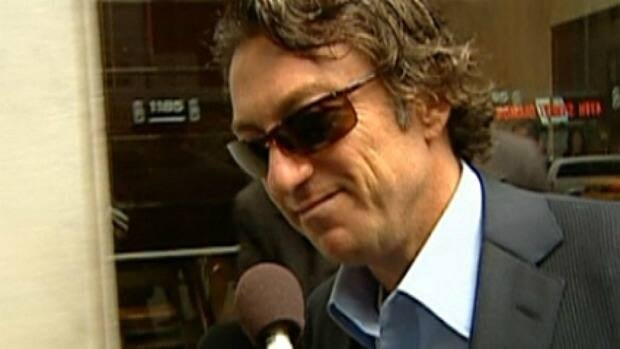 Oilers owner Daryl Katz speaks briefly with media while entering NHL headquarters in New York City last year.