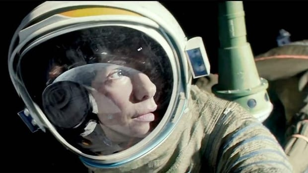Sandra Bullock co-stars with George Clooney as astronauts stranded in space in Alfonso Cuaron's 3D drama Gravity.
