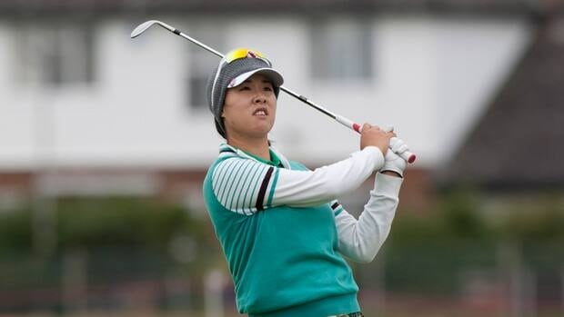 Haeji Kang of Korea plays towards the 18th green during the first round of the Women's British Open golf championships at Royal Liverpool Golf Club, Hoylake, England, Thursday.