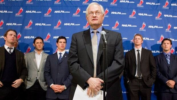 NHLPA Executive Director Donald Fehr, centre, stands in front of players in this file photo. The players approved ratification of a deal with owners on Saturday.