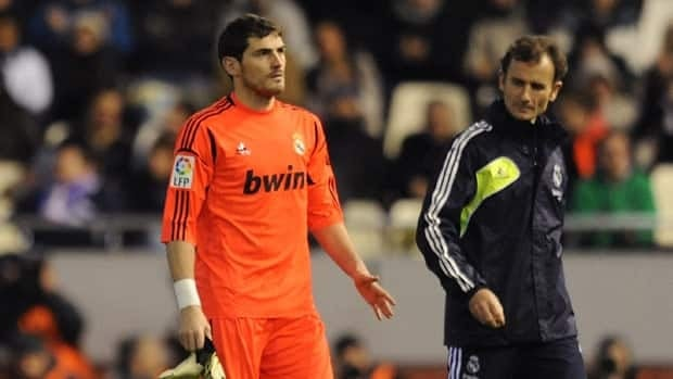 Iker Casillas of Real Madrid leaves the field after injuring his left hand during the Copa del Rey quarter-finals.