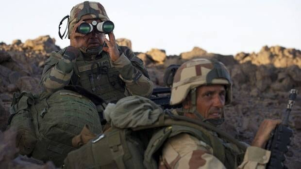 French soldiers patrol the desert in Northern Mali as part of their operations in the country, where a France-led attack killed al-Qaeda-linked warlord Abou Zeid.