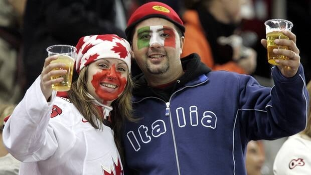 A Canadian and Italian hockey fan enjoy a beer during a hockey game. Without NHL hockey, beer sales are down across the country.