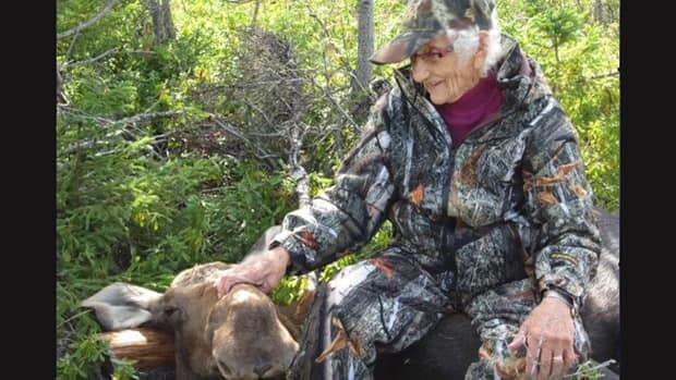 Laura Wood and the moose she shot.
