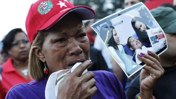 Supporters of Venezuela's President Hugo Chavez, who died Tuesday after a battle with an undisclosed type of cancer, react to the announcement of his death.