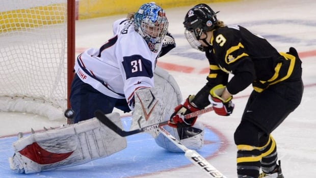 Canada's Jennifer Wakefield scores the game-winning goal against U.S. goalie Jessie Vetter Tuesday during both nations' opening game at the women's world championship in Ottawa.