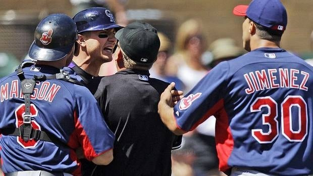 Rockies' Troy Tulowitzki, second from left, and Indians starting pitcher Ubaldo Jimenez are restrained by Cleveland catcher Lou Marson and home plate umpire Clint Fagan after Jimenez hit Tulowitzki with a pitch.