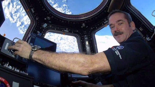 Canadian astronaut Chris Hadfield, seen in an undated photo from space, will publish his first book in October.