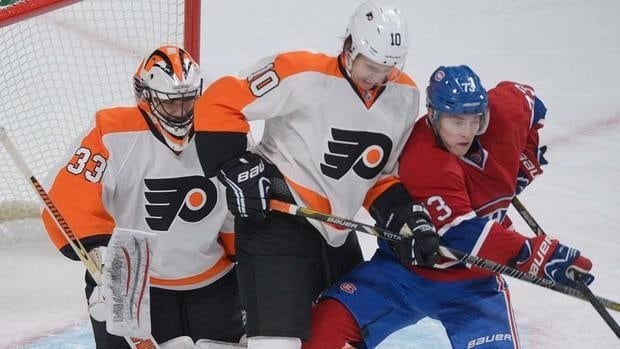 Montreal Canadiens' Brendan Gallagher, right, pressures Philadelphia Flyers' goalie Brian Boucher in the first period of the Habs' victory on Saturday. Gallagher would suffer a concussion in the third.