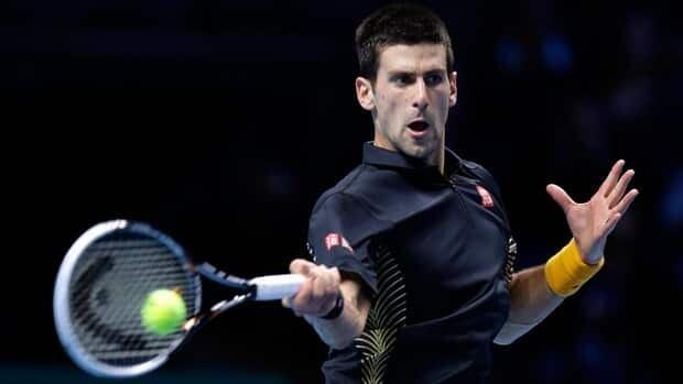 Novak Djokovic of Serbia plays a return to Juan Martin Del Potro of Argentina, during their ATP World Tour Finals singles semifinal in London, Sunday.