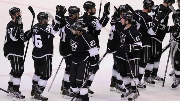Members of the Los Angeles Kings celebrate their 2-1 win over the Phoenix Coyotes to take a 3-0 series lead on Thursday.