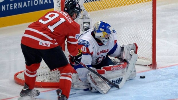 Canada's Steven Stamkos tries to tuck the puck past Slovenia's goalie Luka Gracnar on Monday at the world hockey championship in Stockholm,Sweden.