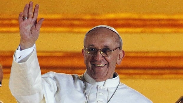 Pope Francis waves to the crowd from the central balcony of St. Peter's Basilica at the Vatican on March 13, 2013.