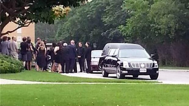 Family and friends attend a funeral for a two-year-old Milton, Ont., boy who died of heat-related causes after being left inside a car last week.
