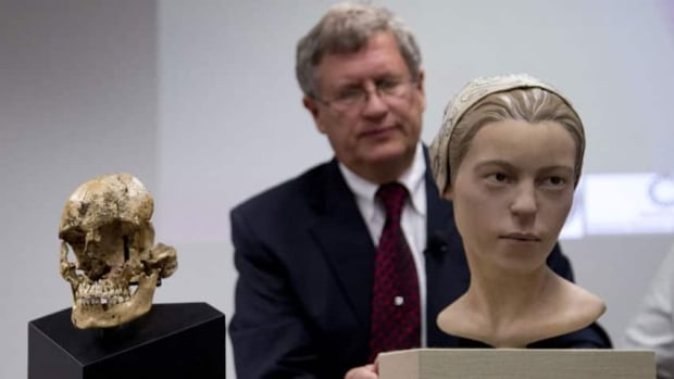 Doug Owsley, division head for physical anthropology at the Smithsonian's National Museum of Natural History, displays the skull and facial reconstruction of Jane of Jamestown. Scientists announced during a news conference that they have found the first solid archeological evidence that some of the earliest American colonists at Jamestown, Va., survived harsh conditions by turning to cannibalism.