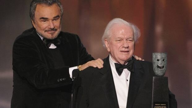 Actor Charles Durning, right, accepts the life achievement award from Burt Reynolds at the Screen Actors Guild Awards in Los Angeles on Jan. 27, 2008. The two starred in 1982's The Best Little Whorehouse in Texas. Durning, a two-time Oscar nominee dubbed the king of character actors, died on Monday.