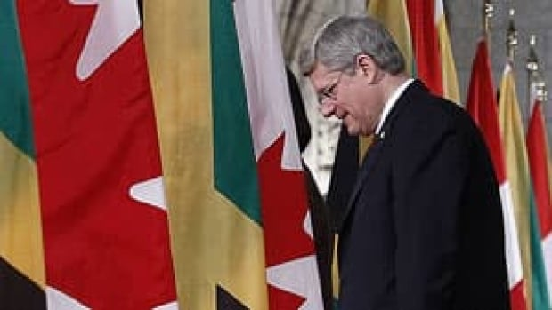 Prime Minister Stephen Harper defended his government's decision on Petronas's bid for Progress Energy during a news conference with the visiting prime minister of Jamaica on Parliament Hill Monday.