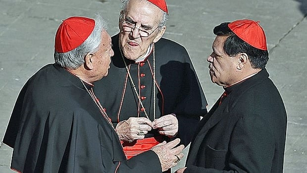 A clutch of cardinals, including Cardinals Rivera Carrera (R) and Javier Lozano Barragan (C) of Mexico chat in St. Peter's Square at the Vatican on Wednesday, following the last general audience of Pope Benedict XVI.