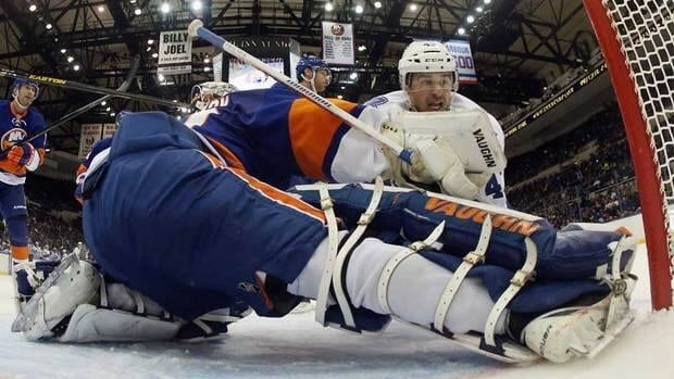 Nazem Kadri, top, of the Toronto Maple Leafs scores his third goal of the game at 14:12 of the second period against New York Islanders goalie Evgeni Nabokov at the Nassau Veterans Memorial Coliseum on Thursday in Uniondale, N.Y.