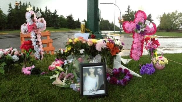Family and friends of the two crash victims placed flowers near the scene of the crash.