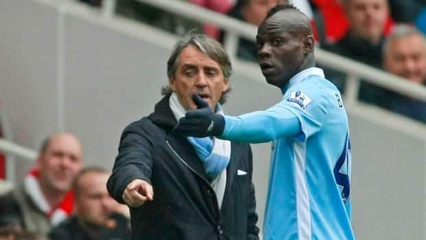 In this April 2012 file photo, of  Manchester City's Mario Balotelli, right, speaks to team manager Roberto Mancini in a match against Arsenal. The two appeared to get into a training ground altercation Thursday.