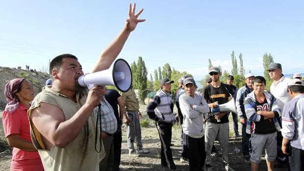 A man addresses protesters in the village of Tamga, Kyrgyzstan. The government imposed a state of emergency on the northern district where the village is located after protestors stormed the Kumtor mine, owned by Canada's Centerra Gold.