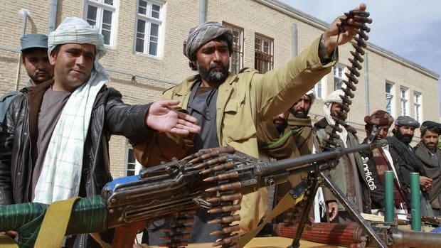 Former Afghan Taliban members hand over their weapons after joining the Afghan government's reconciliation and reintegration program in Herat province on March 19, 2013.