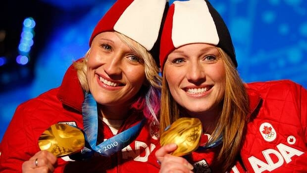 Canadian bobsleigh gold medallists Heather Moyse, right, and her teammate Kaillie Humphries pose with their medals at Whistler Olympic Park during the 2010 Winter Olympic Games.