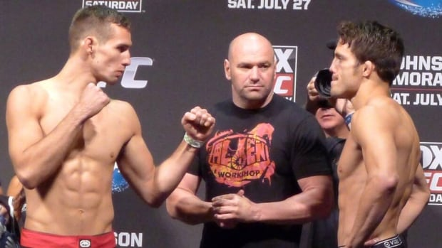 Canadian welterweight Rory MacDonald (left) and Jake Ellenberger pose at their weigh-in for their co-main event at Saturday's UFC card in Seattle on Friday. MacDoinald defeated Ellenberger via decision.