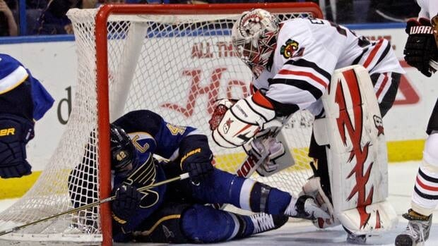 St. Louis Blues' David Backes (42) crashes into the net behind Chicago Blackhawks goalie Ray Emery (30) in the second period on Tuesday in St. Louis.