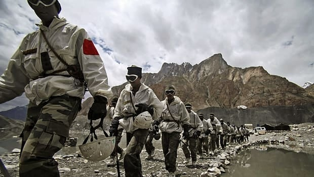 Indian army soldiers return after a training session at the Siachen glacier base camp in Kashmir on July 19, 2011.