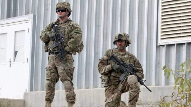 U.S. soldiers with stand guard as they watch the transfer ceremony of security responsibilities from NATO troops to Afghan security forces south of Kabul in Afghanistan. The Obama adminiistration has said it won't rule out a complete withdrawal of troops from Afghanistan after 2014.