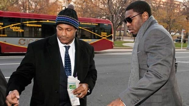 New Orleans Saints defensive end Will Smith, left, and linebacker Jonathan Vilma had their suspensions overturned on Tuesday.